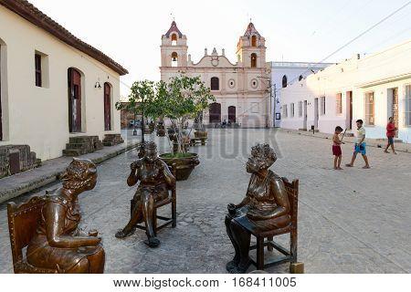 Camaguey Cuba - 11 January 2016: Statues of artist Martha Jimenez in front of the Carmen church at Camaguey on Cuba