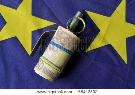 Euro banknotes,EU and Ukraine flags and Ukrainian grenade detonator