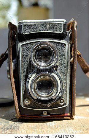 Old Vintage camera on a wooden floor