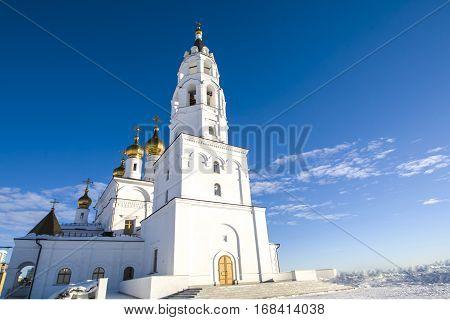 Modern white Orthodox Church against the bright blue sky
