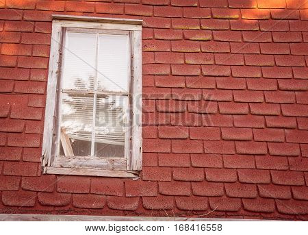 White wooden window on an abandon house