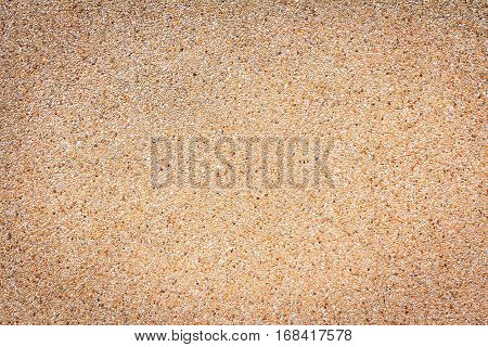 Small sand stone of sand wall texture or sand wall background for design with copy space for text or image.