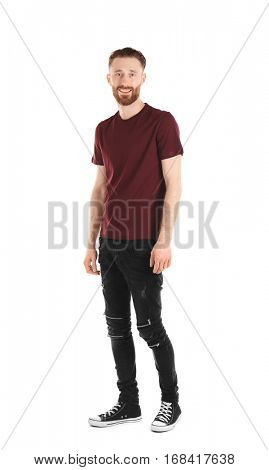 Young handsome man in claret red T-shirt isolated on white