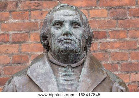 Copenhagen, Denmark, January 21, 2017: Bronze statue of the reformer Martin Luther in front of Luther church. On October 31, 2017, it marks the 500 anniversary of that he nailed his 95 theses.