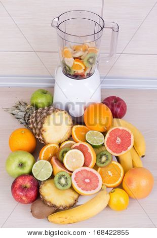 Blender With Group Of Fruits