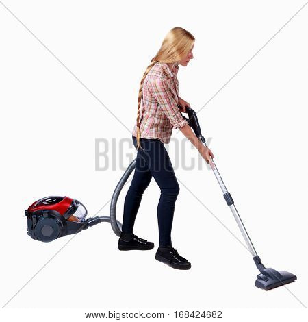 Rear view of a woman with a vacuum cleaner. She is busy cleaning. Rear view people collection.  backside view of person.  Isolated over white background. Side view pylesosyaschuyu cleaner.