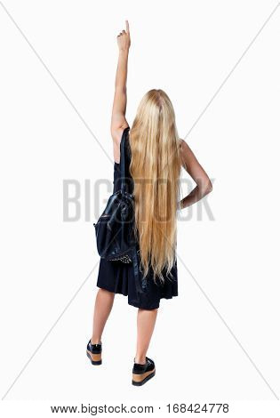 Back view of  pointing woman. beautiful girl. Rear view people collection.  backside view of person.  Isolated over white background. Long-haired blonde with a leather backpack is pointing to the top.
