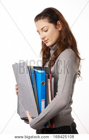 Happy highschool student girl holding folders, isolated on white.