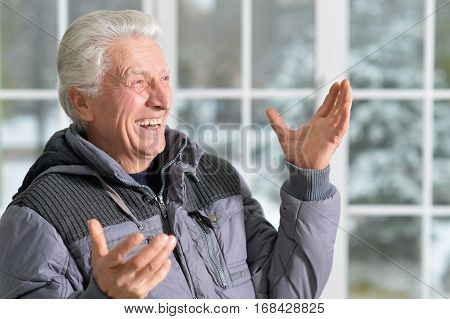 Portrait of a smiling senior man, close up