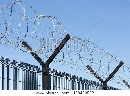 Barbed wire and razor wire security fence