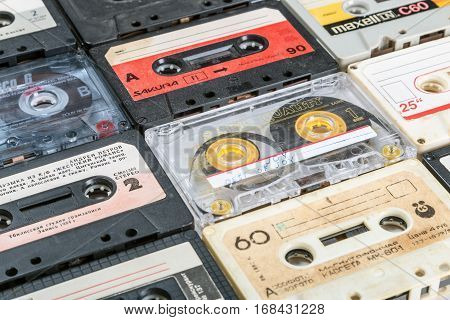 Moscow, RUSSIA - May 24, 2016: Old Cassette tapes over background. Cassette tapes of different firms Maxell, Sakura, Svema etc