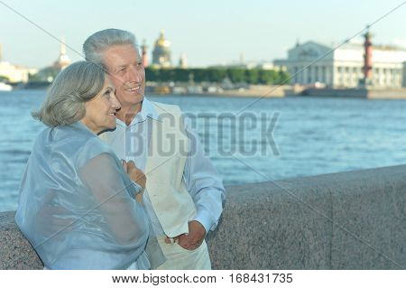 Happy Mature couple enjoy fresh air and stunning view on vacation