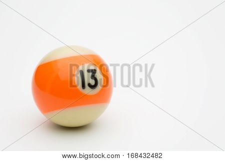 Number thirteen pool ball on a white background