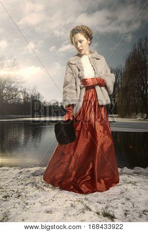 Pretty woman on walk in winter park