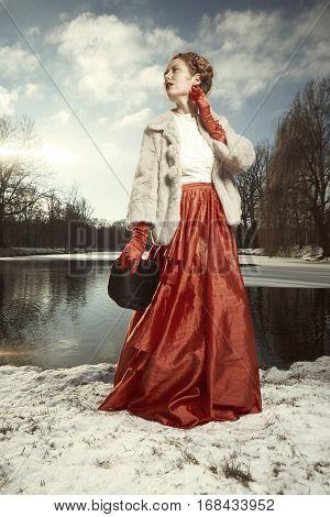 Nice woman on walk in winter park