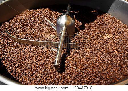 Coffee roaster machine full of coffee beans.