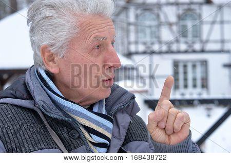 senior man having an idea, close up