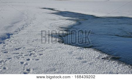 river winter ice snow, flowing blue water flow, of winter nature landscape