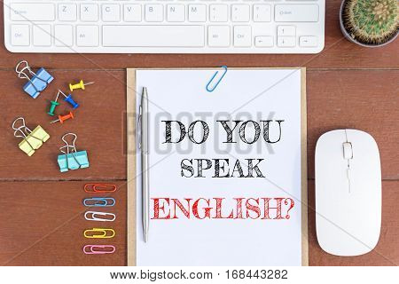 Text Do you speak English on white paper which has keyboard mouse pen and office equipment on wood background / business concept.