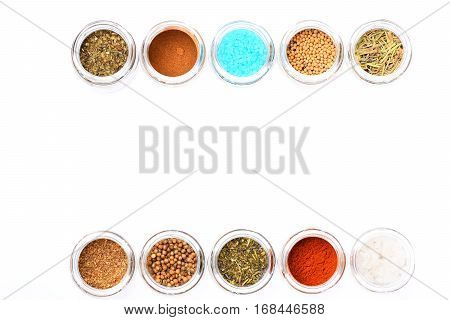 Various Spices In Jars On White Background