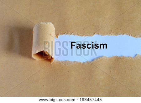 Fascism Word Written Under Ripped And Torn Paper.