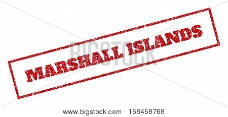 Red rubber seal stamp with Marshall Islands text. Vector message inside rectangular banner. Grunge design and scratched texture for watermark labels. Inclined sign.