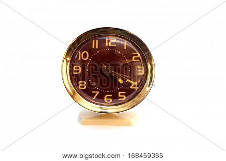 Vintage wind up alarm clock pointing to the time of 4:20 am or pm. Isolated on white with room for your text.