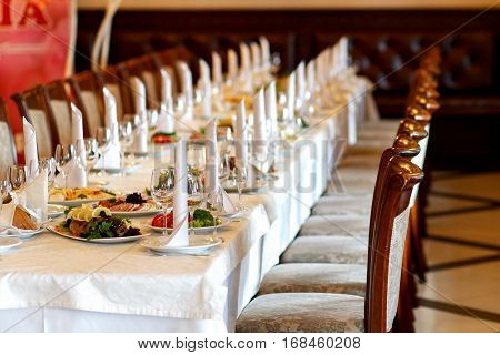 Stylish Table With Food And Drinks Setting For Guests At Elegant  Wedding Reception, Catering In Res