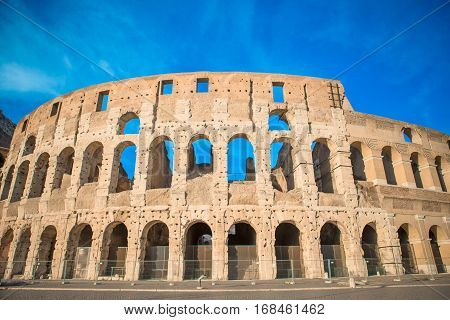 Colosseum background blue sky in Rome, Italy