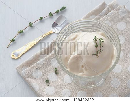 Banana mousse. Soft homemade ice cream. Fresh zabaglione with thyme and vanilla. Custard cream. Top view. Close up.