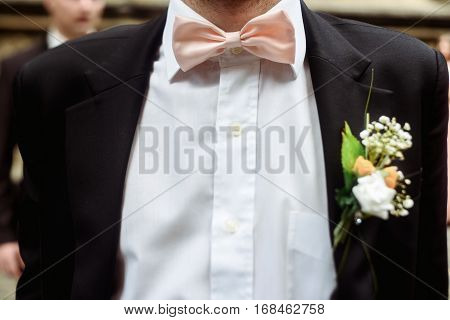 Luxury Stylish Groom With Boutonniere On Elegant Suit And Bow Tie Close-up At Wedding Ceremony