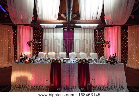 Stylish Decorated Tables With Bouquet Of Roses And Food For Wedding Reception, Catering In Restauran