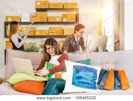 Group of active young people working on startup small business at home online marketing shopping delivery or home business teamwork concept