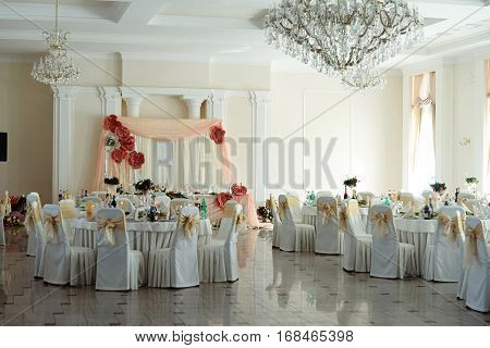 Luxury Decorated Round Tables With Delicious Food  At Wedding Reception In Restaurant