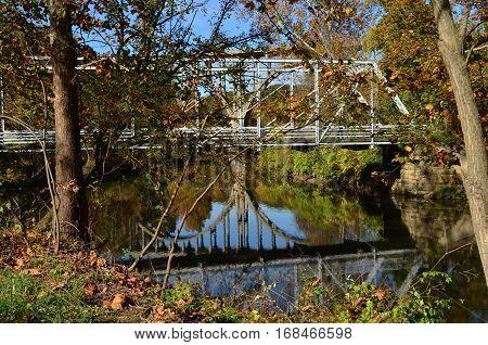 Reflection of bridge overpass and Walking bridge over river