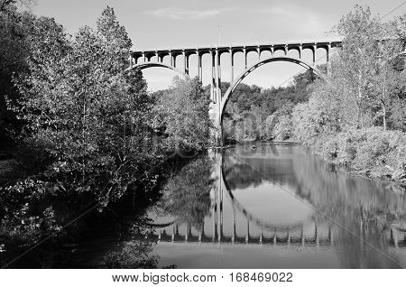 Black and white bridge overpass and reflection