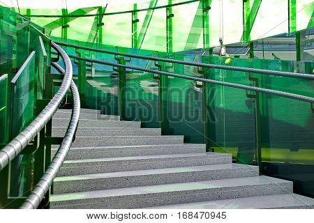 Modern Stairway with green glass going upwards