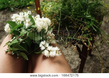 Beautiful White Flowers On Legs At Rustic Wooden Chair, Decor And Arrangements, Simple Adorning