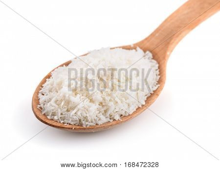 Wooden spoon of coconut shavings isolated on white