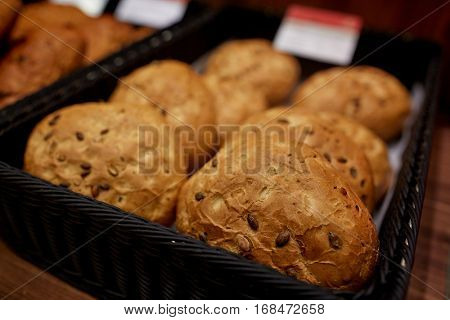 food, baking and sale concept - close up of bread at bakery or grocery store