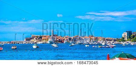 View at seafront panorama of mediterranean town Budva, european travel places in Montenegro.