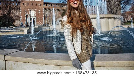Happy Young Tourist Woman In Milan, Italy Looking Into Distance