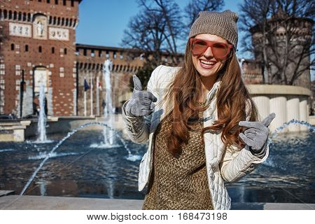 Woman Near Sforza Castle In Milan, Italy Showing Thumbs Up