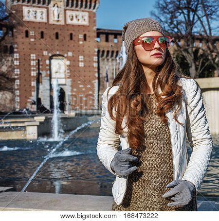 Young Tourist Woman In Milan, Italy Looking Into Distance