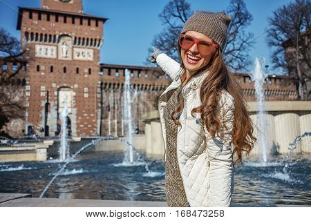 Happy Traveller Woman In Milan, Italy Pointing At Sforza Castle