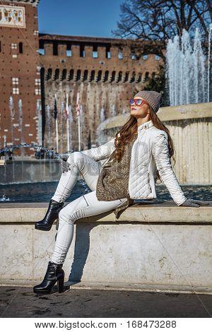Trendy Woman In Milan, Italy Sitting Near Fountain