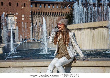 Traveller Woman In Milan, Italy Speaking On Mobile Phone