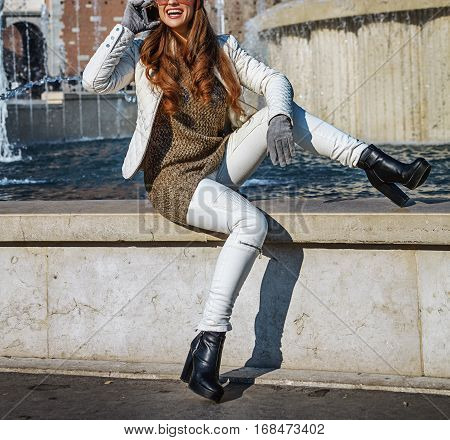 Smiling Traveller Woman In Milan, Italy Talking On Mobile Phone