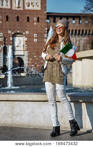 Traveller Woman In Milan With Italian Flag Looking Into Distance