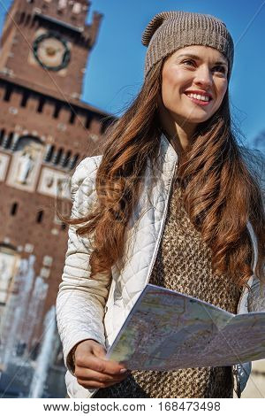 Rediscovering things everybody love in Milan. happy trendy woman in Milan Italy with map
